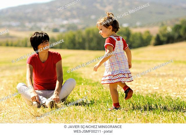 Mother and little daughter enjoying a day together at countryside