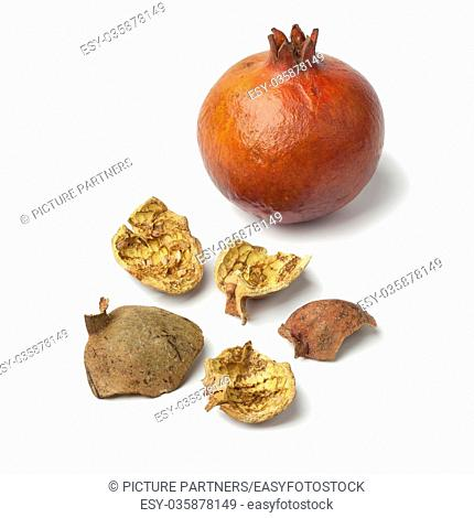 Moroccan dried pomegranate peel on white background