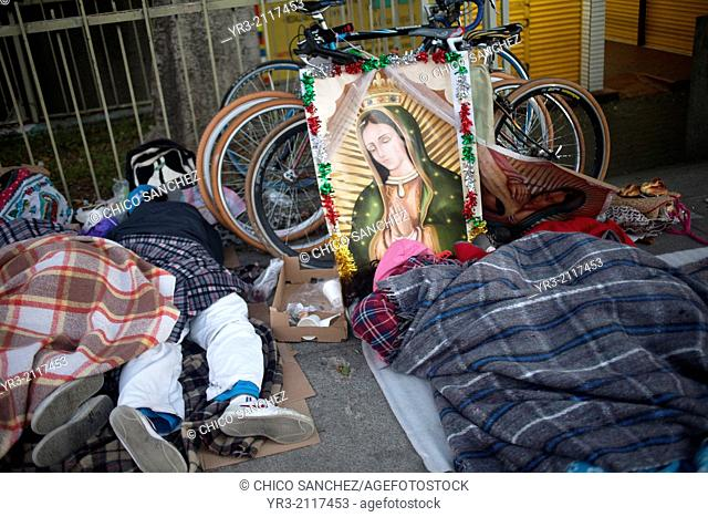Pilgrims sleep by their bicycles at the pilgrimage to Our Lady of Guadalupe Basilica in Mexico City, Mexico, December 10, 2013