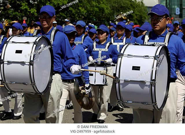 An Asian marching band performs at a festival in downtown Toronto. - TORONTO, ONTARIO, CANADA, 01/08/2009