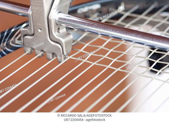 Tennis Racket in Stringing Machine Being Repaired