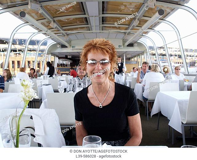 Woman on a dinner cruise on the St. Lawrence in Montreal, Quebec. Canada