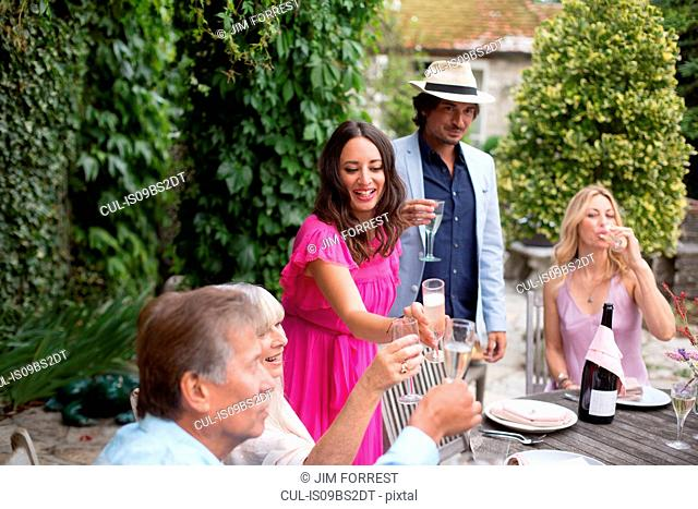 Guests enjoying and celebrating at garden party