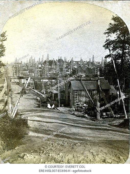 The Pennsylvania oil region. West side of Triumph Hill, near Tidioute, Pennsylvania with buildings, storage tanks, and derricks. 1875