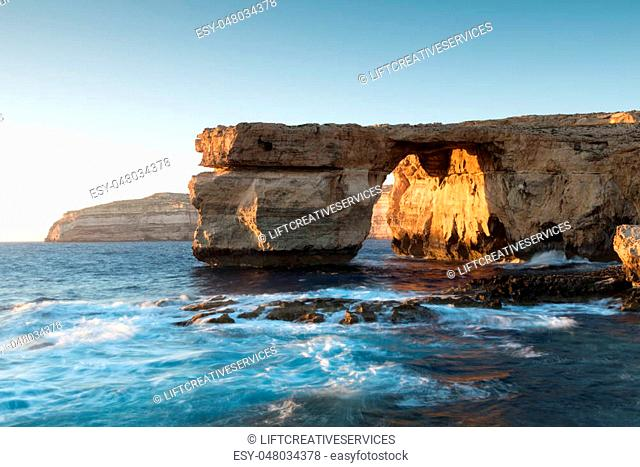 Limestone arch, at sunset know as the Azure Window, in Dwerja, Gozo, Malta.This location was used as a wedding scene in Game of Thrones