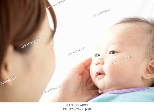 Mother Touching Newborn Baby's Face