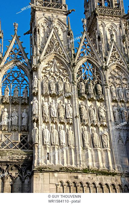 Stone statues of prophets, apostles, and archbishops, central doorway, western facade, on exterior of Cathedral Notre Dame dating from the 12th century, Rouen