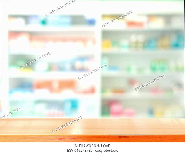 Wooden tabletop for products display with blurred of drugs store background