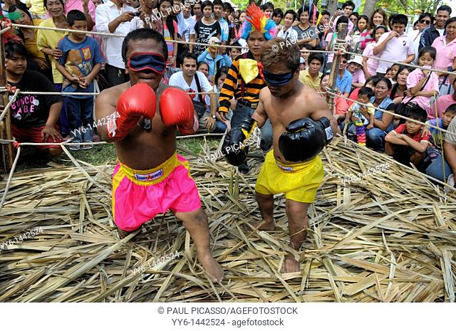 Dwarf kick bokers fighting blind fold, crazy sport during kings birthday celebrations, suan luang rama 9 park, Bangkok, thailand