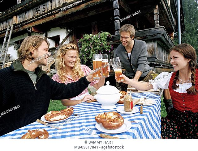 Men, women, young, Almhütte, outside,  Benches, table, bread time, beer, happy,   Series, 20-30 years, pair, friends, clothing, Dirndl, official dress, Bavarian