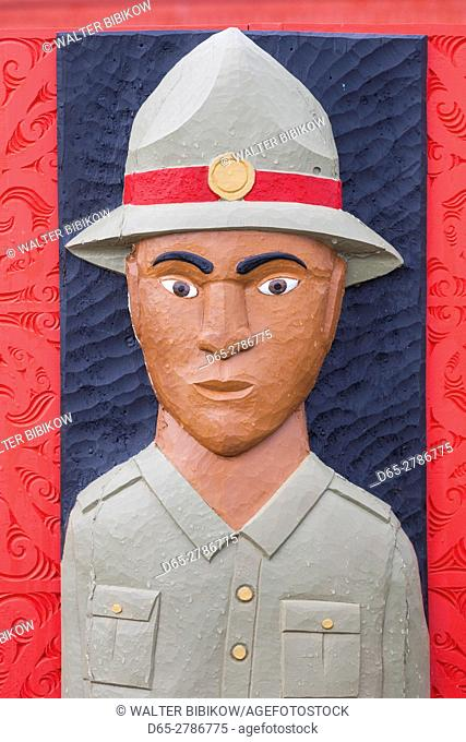 New Zealand, North Island, Rotorua, Ohinemutu, Maori village, wood relief of soldier