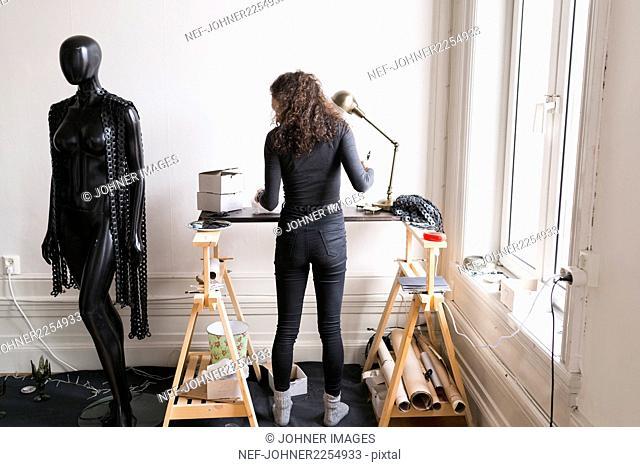 Fashion designer working in her studio