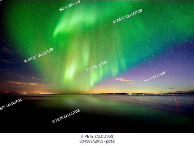 Aurora borealis over Puget Sound at night, Seattle, Washington, USA
