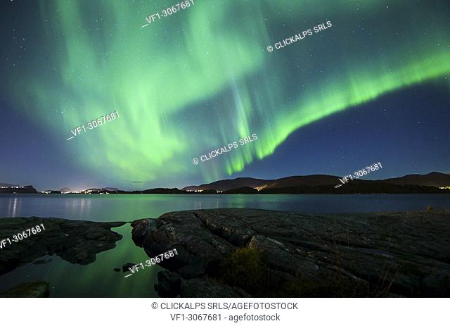 A powerful Northern lights over Alesund city, Vestlandet, More og Romsdal county, Norway, Europe
