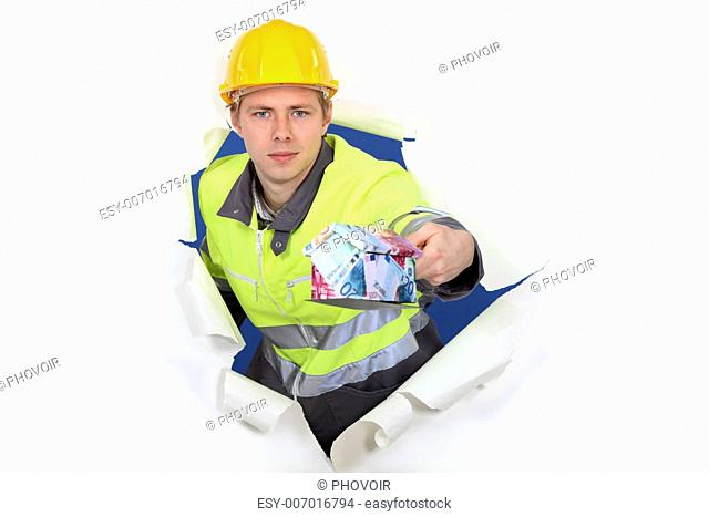 Man with money balancing on trowel