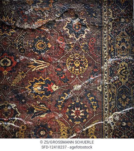 A dark patterned oriental rug