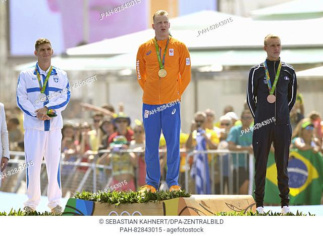 Gold medalist Ferry Weertman of the Netherlands (C) is flanked by Silver medalist Spiros Gianniotis of Greece and Bronze medalist Marc-Antoine Olivier (R) of...