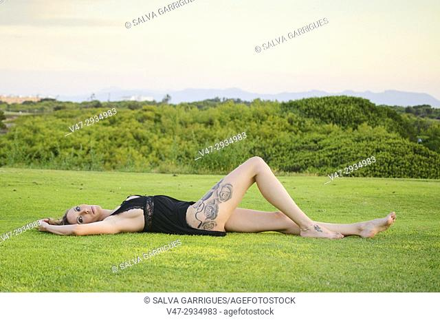 Woman lying on the lawn with underwear, Valencia, Spain