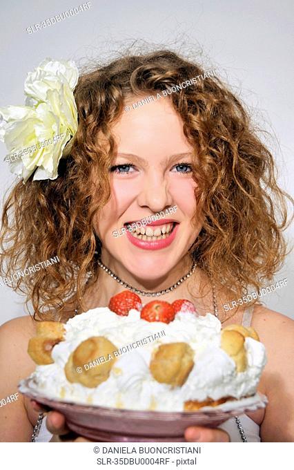 Woman holding fruit profiterole cake
