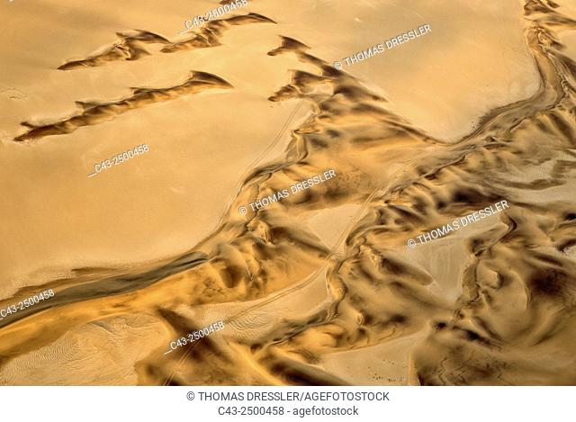 Sand dunes in the Namib Desert near the town of Swakopmund. The recognizable tracks probably have been made by quad bikes which use this aerea for recreational...