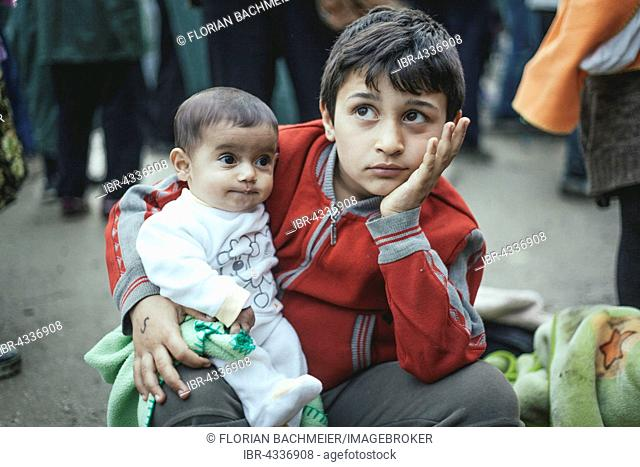 Boy from Syria after arriving with his little brother, refugee camp in Idomeni, border with Macedonia, Greece