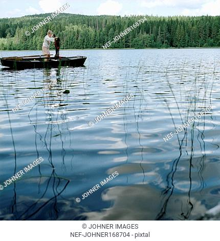 Mature woman in lake with fishing net