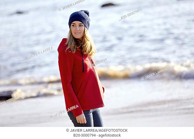 Adult woman on the beach, Santa Clara Island, Donostia, San Sebastian, Gipuzkoa, Basque Country, Spain, Europe, Winter