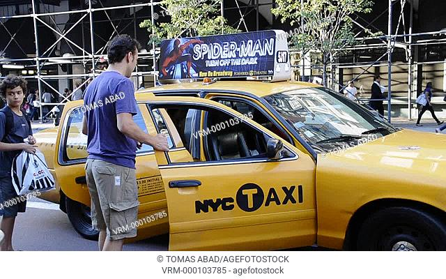Tourist hailing yellow taxi cab, August rush hour afternoon, 34 th Street, Herald Square, Manhattan, Broadway, New York City, USA