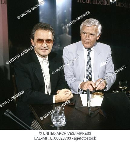 """Der italienische Musikproduzent und Komponist Giorgio Moroder zu Gast bei Joachim Fuchsberger in dessen Talkshow """"""""Heut' abend"""""""", Deutschland 1980er Jahre"""