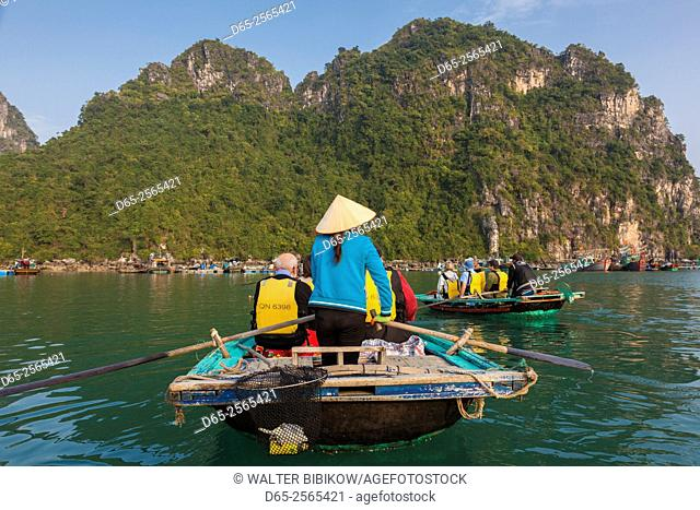 Vietnam, Halong Bay, floating fishing village by rowboat