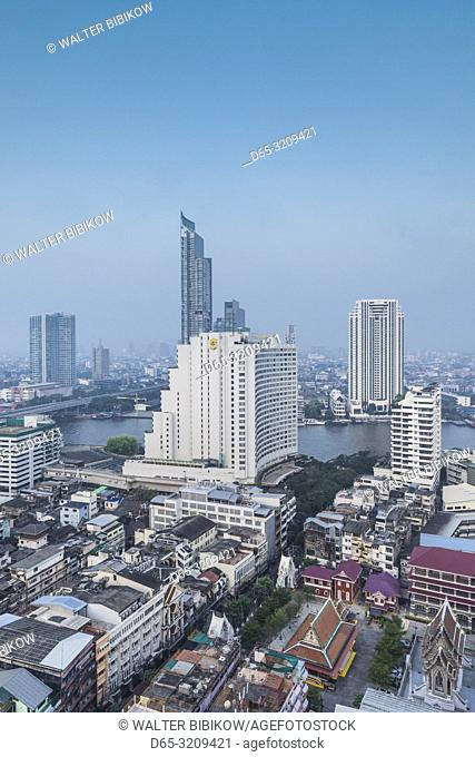 Thailand, Bangkok, Riverside Area, high angle city skyline by Chao Phraya River, dawn