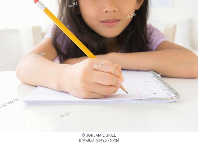 Close up of Vietnamese girl doing homework