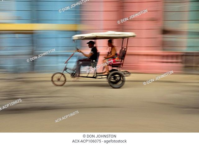 Street photography in central Havana- Bicycle taxi