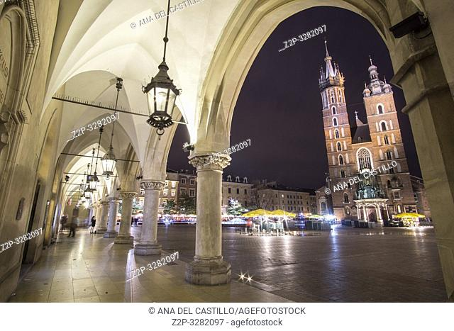 KRAKOW POLAND ON SEPTEMBER 23, 2018: St Mary church from The Cloth Hall by night