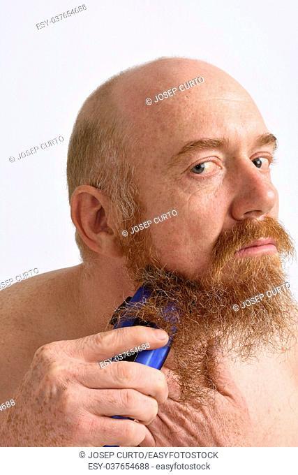 redheaded man shaving his beard