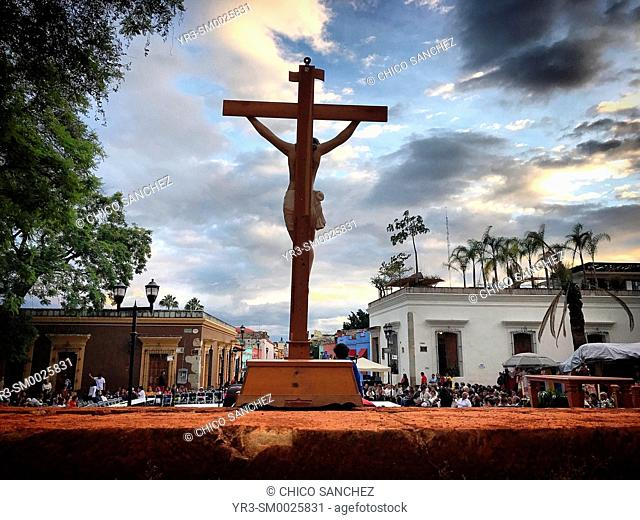 An image of Jesus Christ crucified is displayed during a religious ceremony in the Templo de Santo Domingo of Oaxaca, Mexico