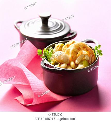 Small casserole dish of Dublin Bay prawns with Paimpol haricot beans