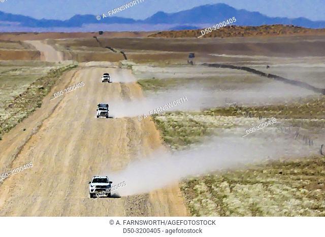 Namibian desert Four wheel drive vehicles on the gravel roads of western Namibia