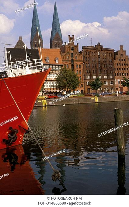 Lubeck, Germany, Europe, Red fire boat moored at a dock on a canal in the Medieval Town of Lubeck