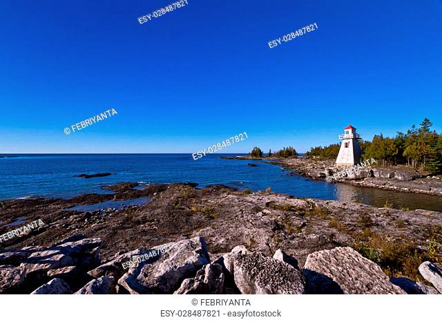 View of light house with blue sky as background