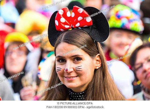 A woman dressed as Minnie Mouse celebrating Weiberfastnacht in Mainz, Germany, 08 February 2018. Photo: Andreas Arnold/dpa