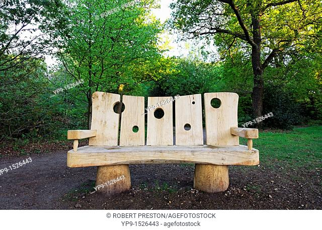 A carved wooden bench at Burnham Beeches, Buckinghamshire, England