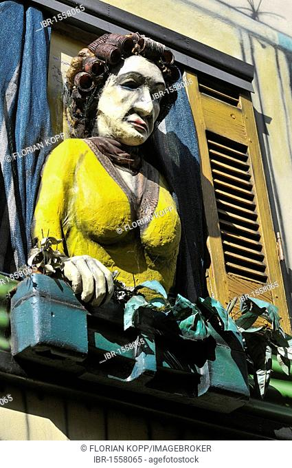 Street art, figure of a working-class woman made of papier-mâché in a window, El Caminito Street, tourist attraction in the former harbour district of La Boca