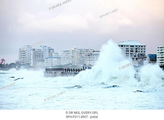 Waves crashing against sea wall, Sea Point, Cape Town, Western Cape, South Africa