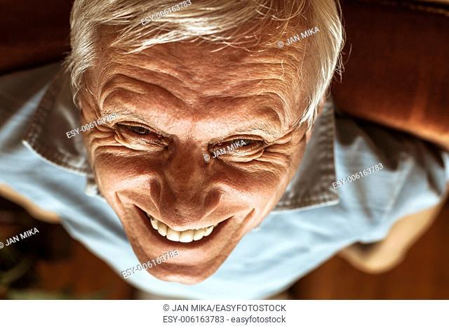 Closeup of senior man face toothy laugh