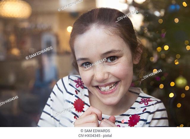 Portrait smiling, confident girl in Christmas living room
