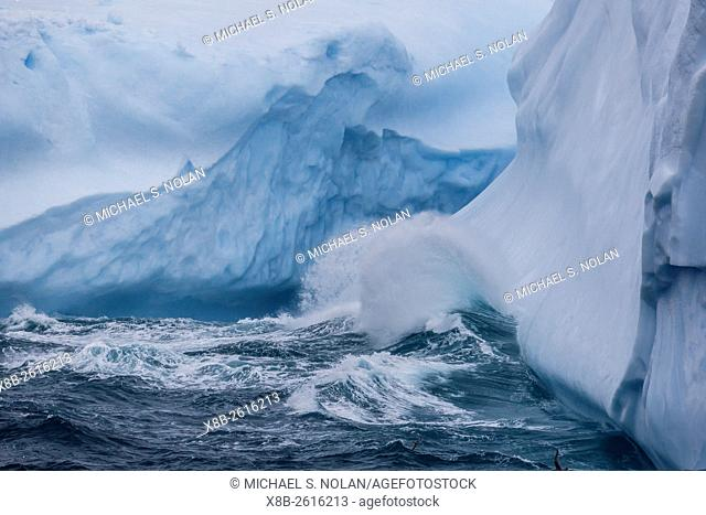 Huge swell breaking on tabular iceberg broken off from B-17A Iceberg near Cooper Bay, South Georgia