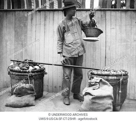 San Francisco, California: c. 1890 A Chinese fruit peddler in Chinatown