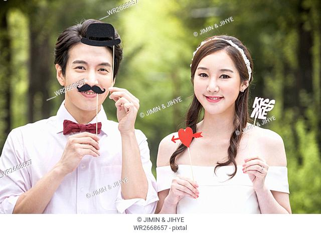 Portrait of young romantic couple posing outdoors