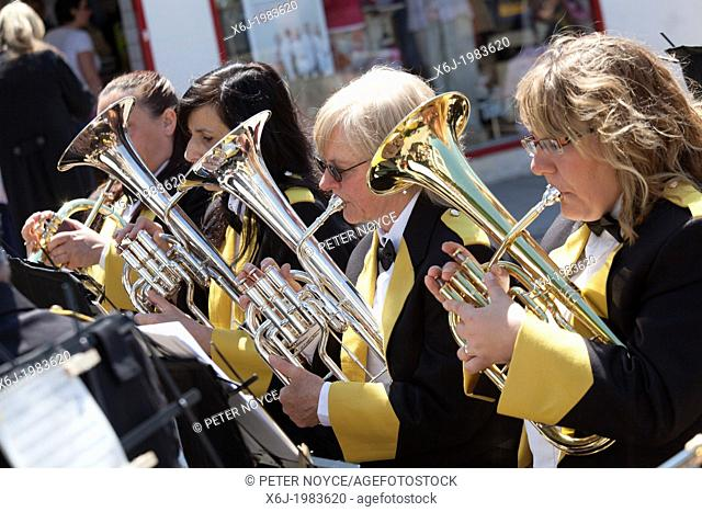 four female in band playing baritone horns